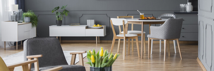 Yellow tulips in grey apartment