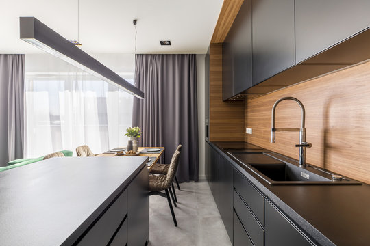 Kitchen interior with black cabinets