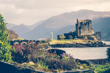 Old Boat Container Garden with Background of The Eilean Donan Castle, Highland, Scotland
