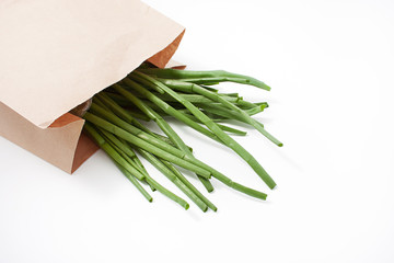 green onion in eco-package on white background. spring natural vitamins
