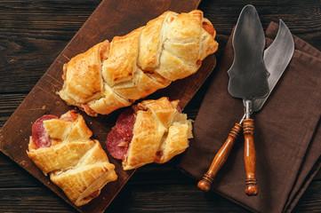 Puff pastry bread with salami and mozzarella.