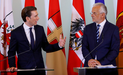 Austria's Chancellor Kurz and Justice Minister Moser address a news conference in Vienna
