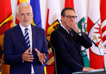 Austria's Vice Chancellor Strache and Minister Moser address a news conference in Vienna