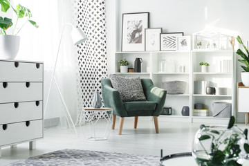 White furniture and green armchair
