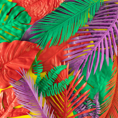 Painted tropical and palm leaves in vibrant bold colors. Concept art. Minimal summer colorful background.