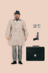 top view of male killer in hat with handgun, money and briefcase isolated on pink background