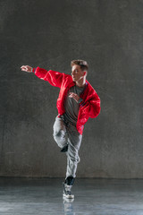Young beautiful male dancer posing in studio