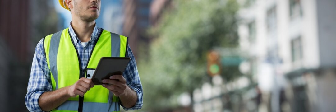 Composite image of concentrated construction worker with tablet