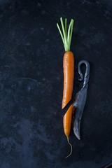 Sliced carrot an an old knife on dark ground