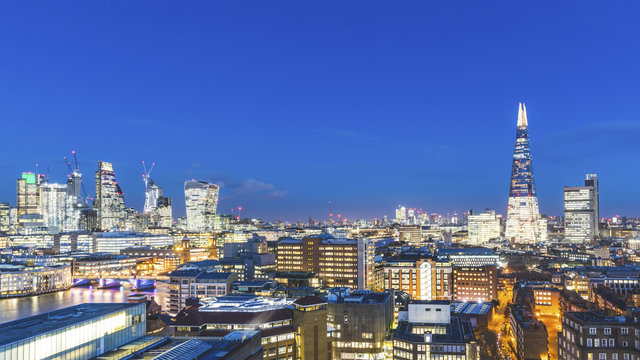 UK, London, cityscape and Thames river panoramic view at dusk