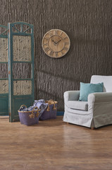 armchair blue box and living room concept wood clock brown panel background wall.