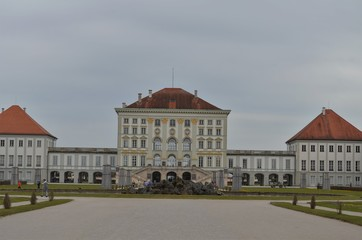 symmetric picture of the Nymphenburg castle in Germany shot on a cloudy day during spring