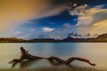 View of the mountains and the lake during the sunrise of Torres del Paine National Park. Autumn in Patagonia, the Chilean side