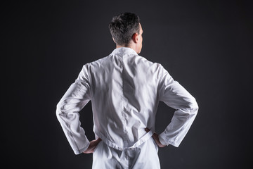 Modern laboratory. Nice smart professional scientist standing in the lab and wearing a labcoat while thinking about his research
