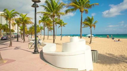 Fototapete - People having a rest on the Fort Lauderdale beach and walking on seafront. RAW video source.
