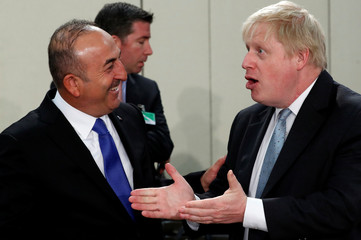 Turkish Foreign Minister Cavusoglu and Britain's Foreign Secretary Johnson attend a NATO foreign ministers meeting at the Alliance's headquarters in Brussels
