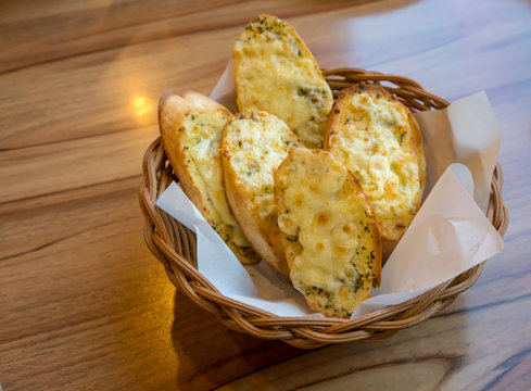 Garlic bread and herb with cheese in the basket