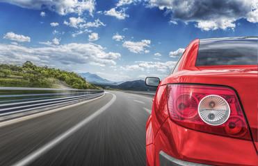 Car rushing along a high-speed highway.