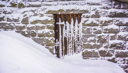 A doorstep blocked by a large amount of snow, winter, Vosges, France.