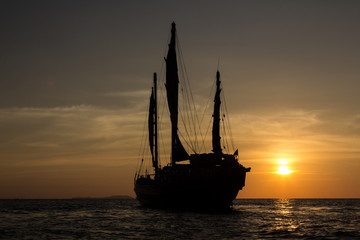 Chinese junk sailing into the sunset in the Indian ocean