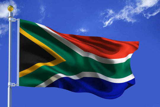 The silk waving flag of South Africa with a flagpole on a blue sky background with clouds .3D illustration.