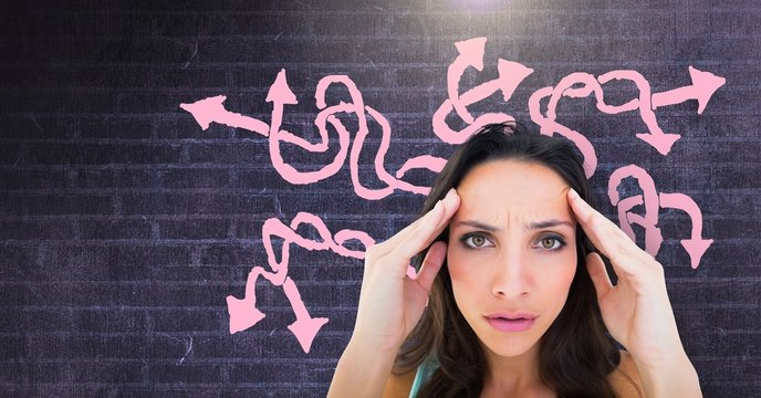 Stressed confused woman with pink arrow squiggly doodles on wall