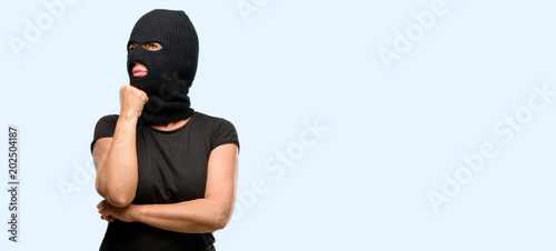 Burglar Terrorist Woman Wearing Balaclava Ski Mask Thinking And Looking Up Expressing Doubt Wonder Isolated