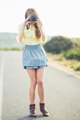 Beautiful stylish photographer taking a picture