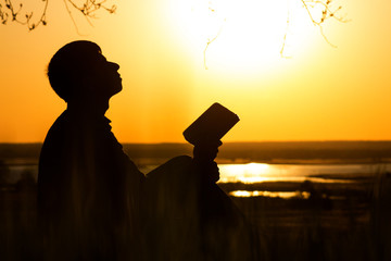 silhouette of man turning to God with hope, the concept of faith and spirituality