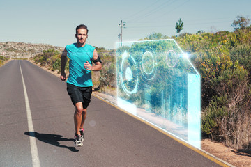 Athletic man jogging on open road against fitness interface