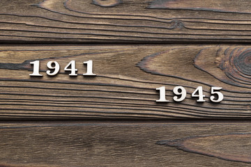 wooden figures in the form of dates 1941-1945 of the Second World War on a wooden background. Victory Day.