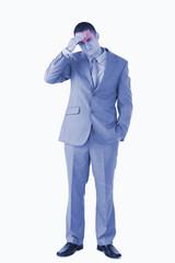 Portrait of a tired businessman having a headache against a white background