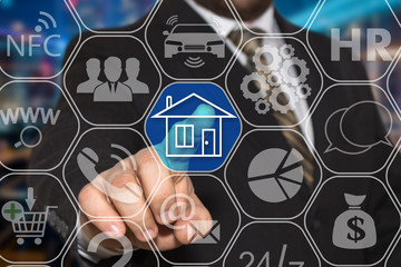 The businessman chooses web icon home on the touch screen .The concept of finding housing for rent or purchase.