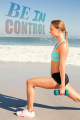 Fit woman doing weighted lunges on the beach against be in control