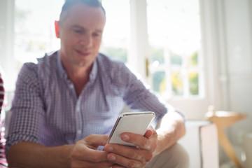 Happy man using mobile phone