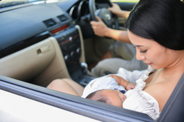 Travel Concepts. Family is driving on the road. Family drive safely with caution. Parents care baby in the car.