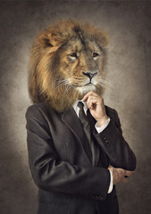 Foto op Canvas Hipster Dieren Lion in a suit. Man with a head of an lion. Concept graphic in vintage style.