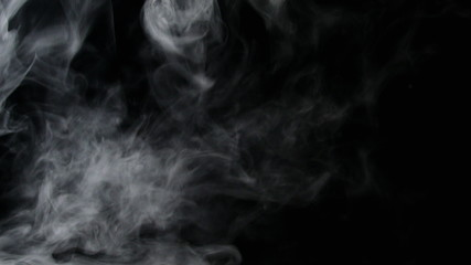 Isolated fog or smoke move on black color background