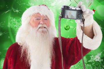 Santa Claus makes a selfie against hanging christmas decorations