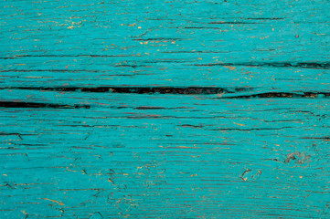 Macrophotography texture of vintage turquoise wood board painted background