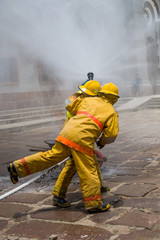 FIREMAN PUTTING OUT THE FIRE