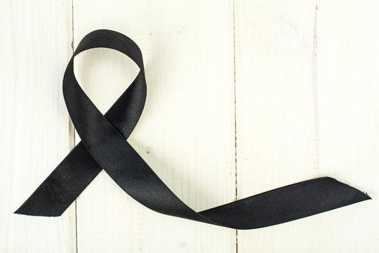Black ribbon-symbol of fight against melanoma and skin cancer