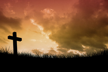 Wooden cross against sky and field