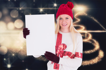 Festive blonde showing a blank page against christmas light design