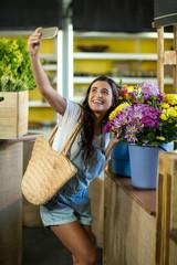 Woman taking a selfie at florist shop