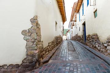 Foto op Canvas Zuid-Amerika land Narrow alley of Cusco (Peru) with cobblestone
