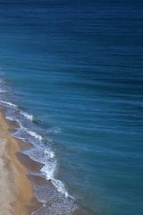 The surf band. Pebble beach. Sea view. Nice view of the sea. The Spanish beach.