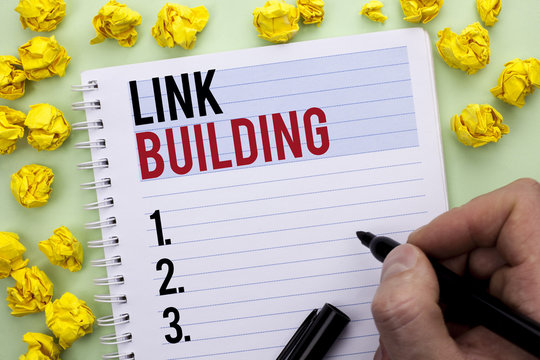 Writing note showing  Link Building. Business photo showcasing Process of acquiring hyperlinks from other websites Connection written By Man Holding Marker on Notebook Book.