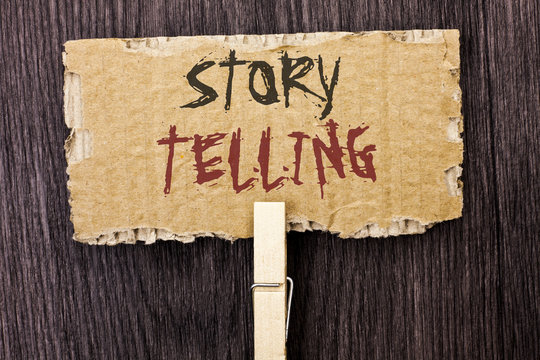 Word writing text Story Telling. Business concept for Tell or write short Stories Share Personal Experiences written on Cardboard Piece Holding With Clip on the wooden background.