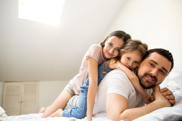 family with daughter having fun at home, the concept of a happy family.
